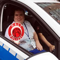 One of our group, Dan Travers, in the all electric VW police car at Göttingen police station